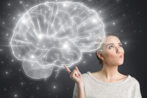 Young girl thinking with illustrated brain